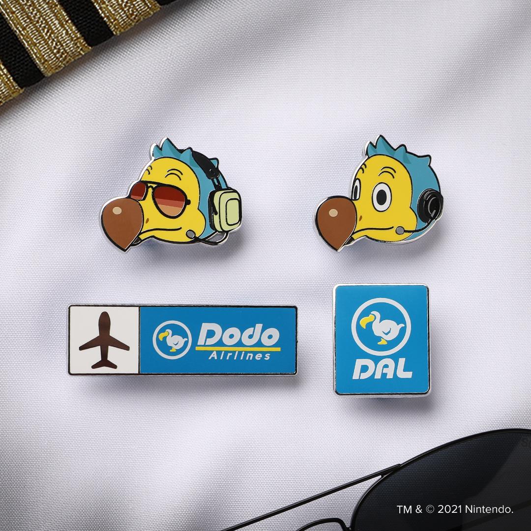 Orville, Wilbur, DAL Logo, and Dodo Airlines Logo pins on a crisp white shirt.